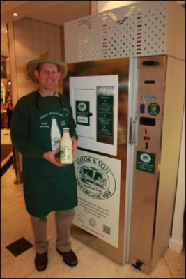 Steve Hook, farmer, at his raw milk vending machine in Selfridges Department Store, London